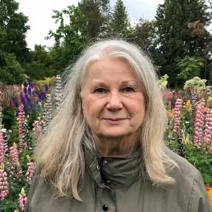 Dari LaRoche headshot in lupin garden